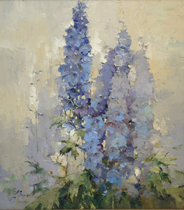 Delphiniums against the sky