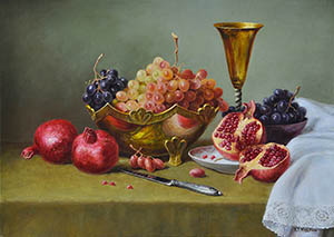 Still life with a pomegranate and grapes