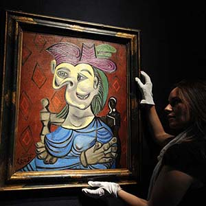 Picasso's Seated Woman in Blue Dress sells at Christie's in New York for $45m